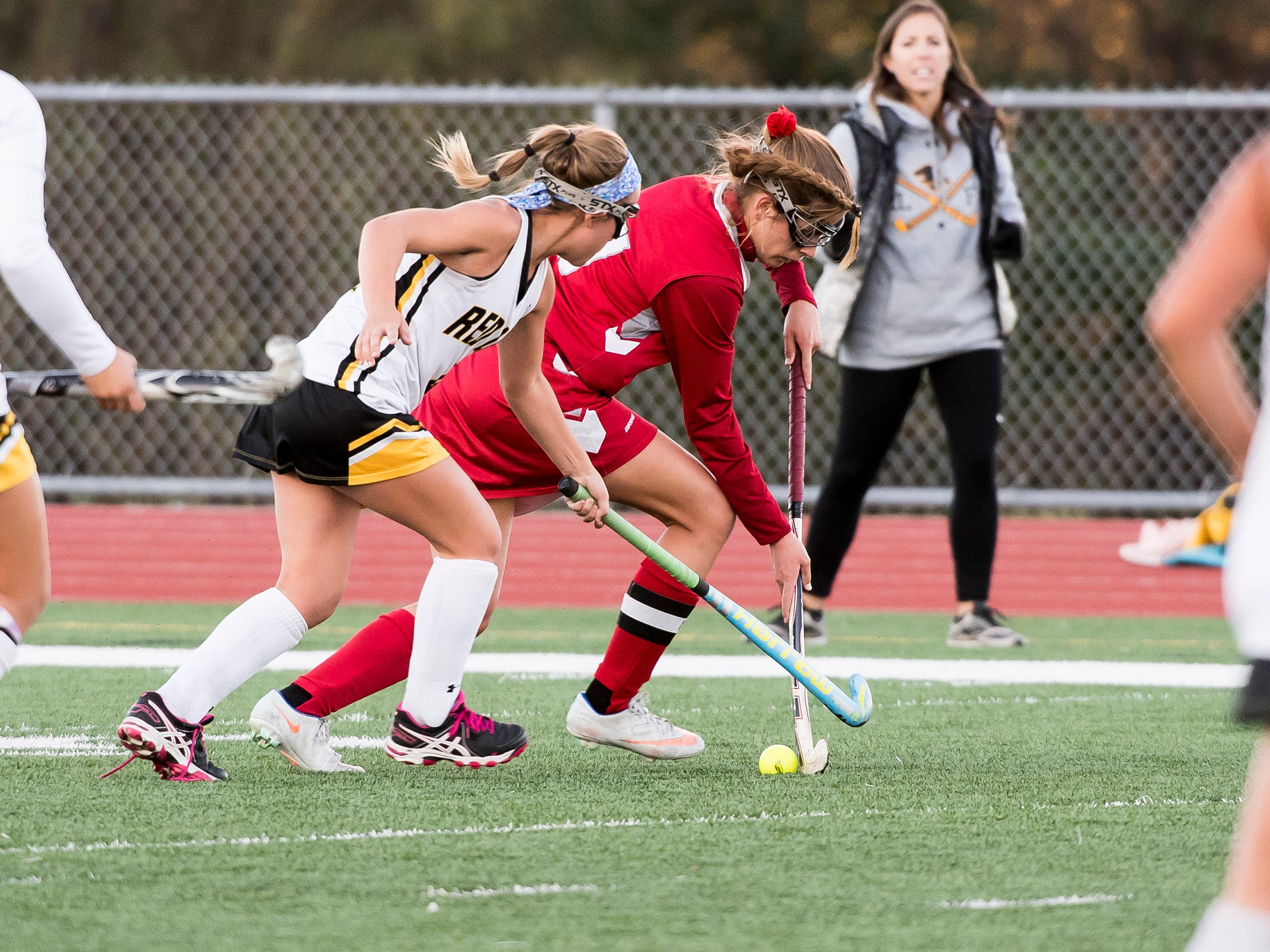 Bermudian Springs' Kaitlyn McCollum fights for the ball with Red Lion's Emma Waltemyer during a YAIAA tournament semifinal game on Thursday, October 18, 2018. The Eagles won 2-0 and will play Central York in the championship game Saturday.