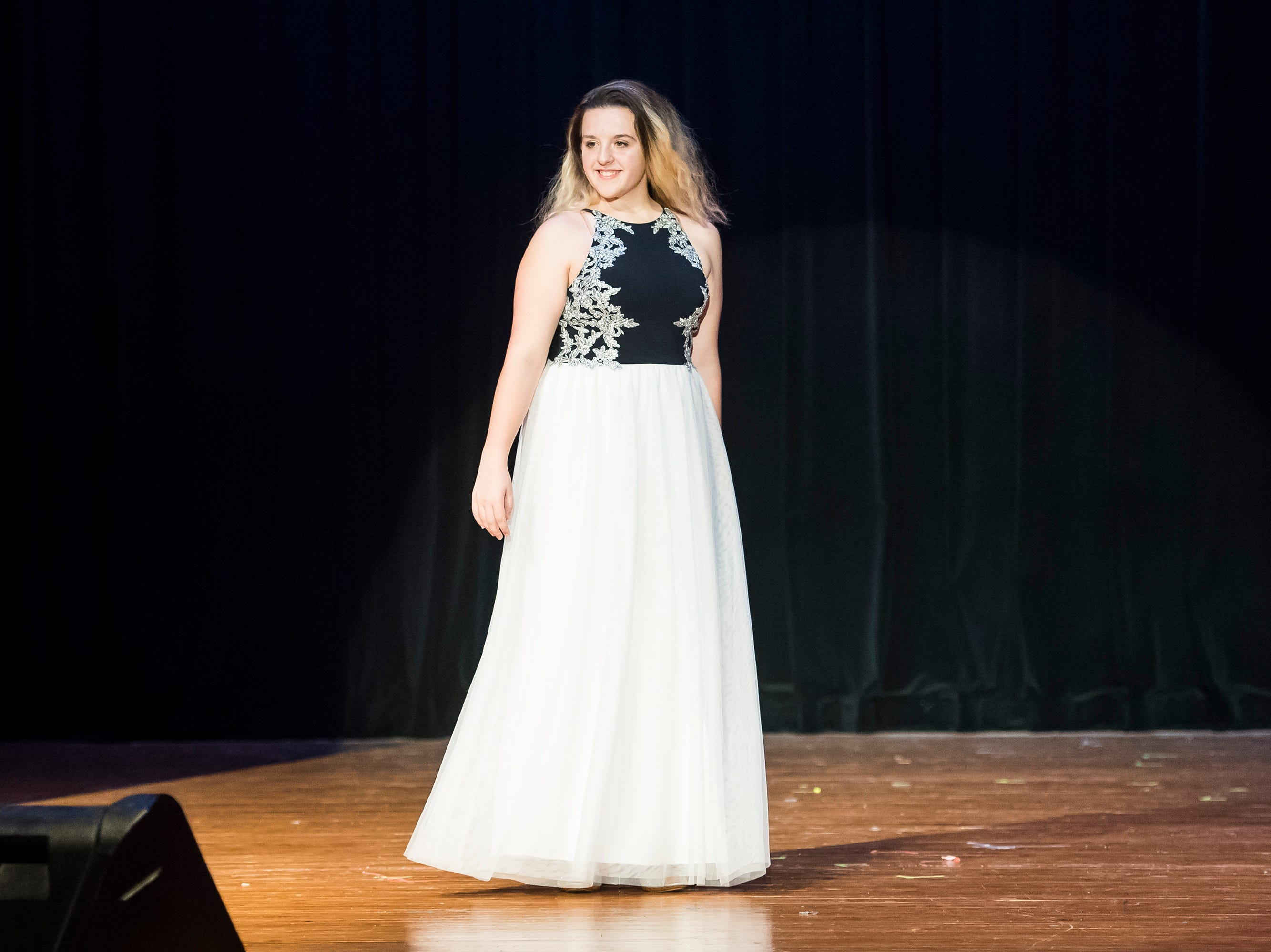 Delone Catholic's Mackenzie Buckley walks on stage in her evening gown during a rehearsal session for the Miss Hanover Area pageant at New Oxford High School on Oct. 17, 2018.