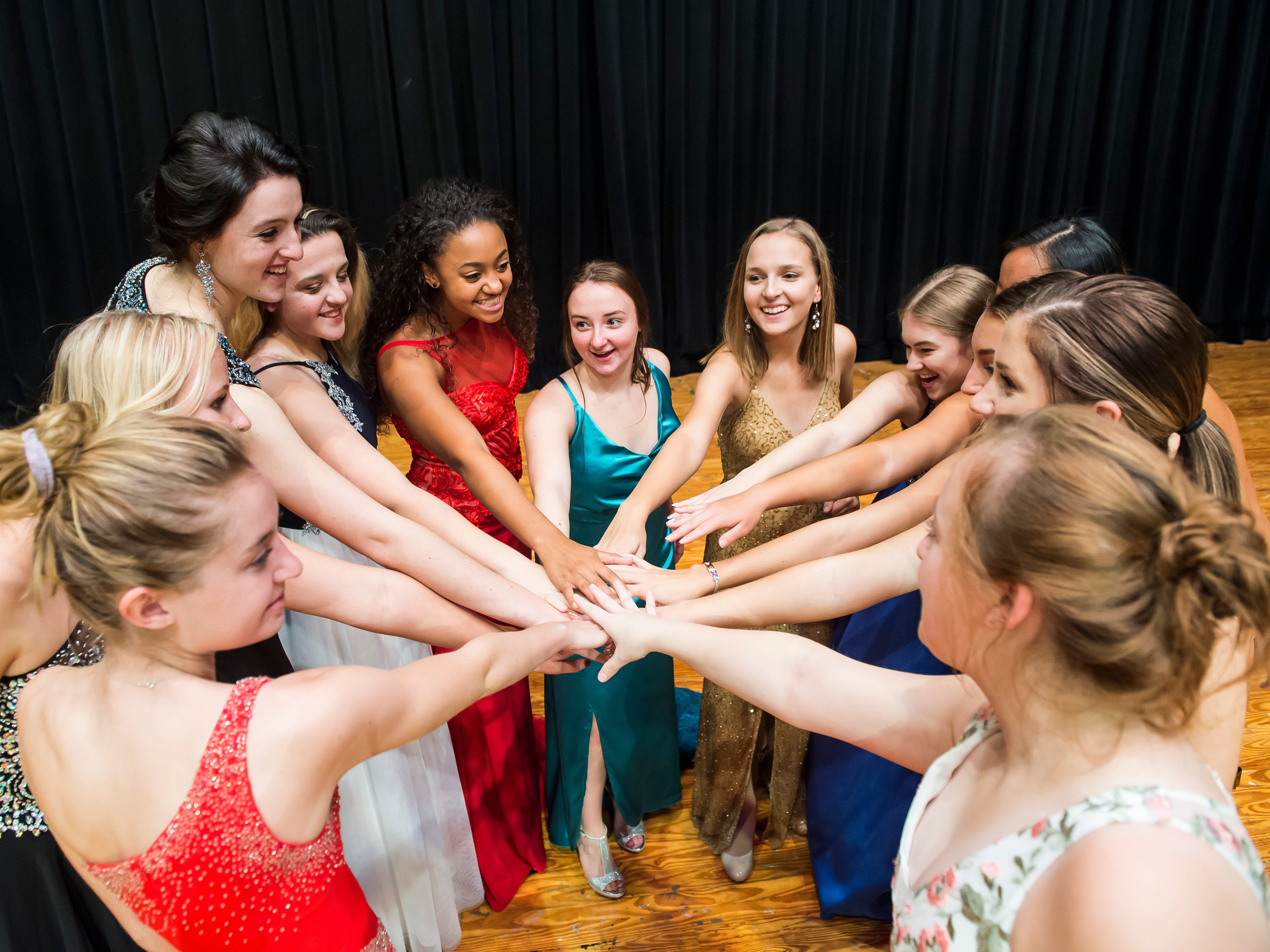 The 12 Miss Hanover Area pageant contestant end a rehearsal session with a chant on Oct. 17, 2018. The pageant will be held Monday, October 22, at 7 p.m. at New Oxford High School.