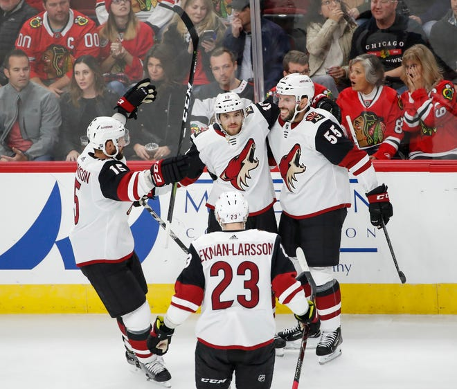 Oct 18, 2018; Chicago, IL, USA; Arizona Coyotes center Vinnie Hinostroza (13) celebrates with teammates after scoring against the Chicago Blackhawks during the second period at United Center.
