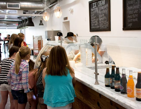 Customers line up to order treats at Ice Cream Sammies in downtown Chandler.