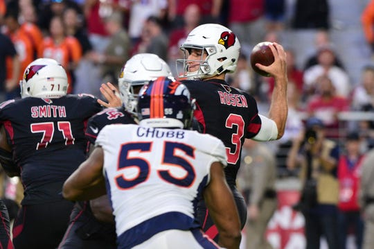 Oct 18, 2018; Glendale, AZ, USA; Arizona Cardinals quarterback Josh Rosen (3) throws an interception as Denver Broncos linebacker Bradley Chubb (55) defends during the first half at State Farm Stadium.
