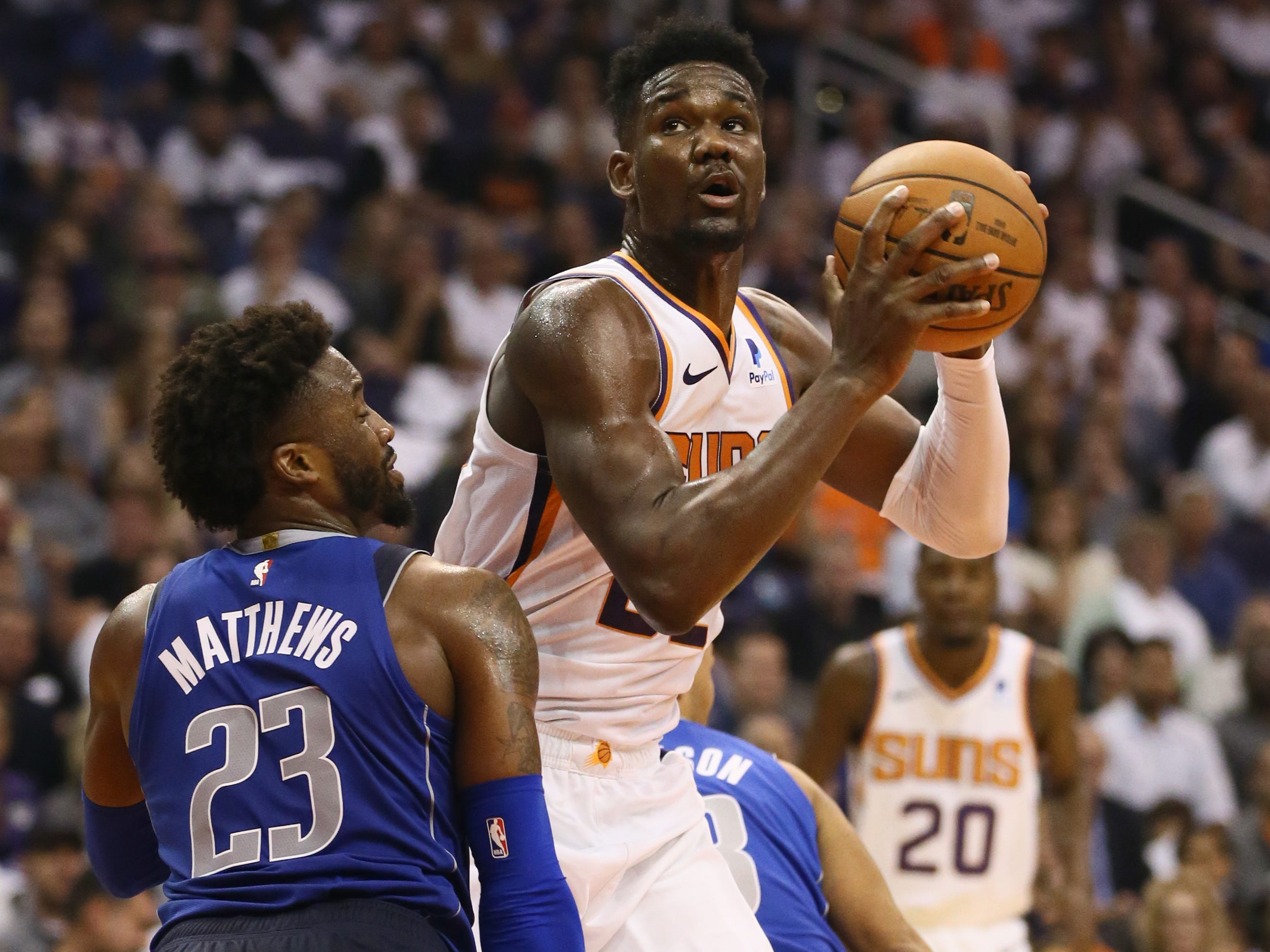 Phoenix Suns Deandre Ayton looks to the basket against the Dallas Mavericks during the season opener at Talking Stick Resort Arena on Oct. 17, 2018, in Phoenix, Ariz.
