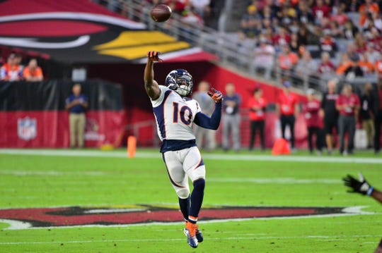 Oct 18, 2018; Glendale, AZ, USA; Denver Broncos wide receiver Emmanuel Sanders (10) throws for a touchdown  during the first half against the Arizona Cardinals at State Farm Stadium.