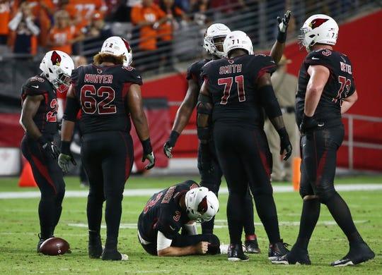 Arizona Cardinals Josh Rosen goes down against the Denver Broncos in the second half at State Farm Stadium in Glendale, Ariz.