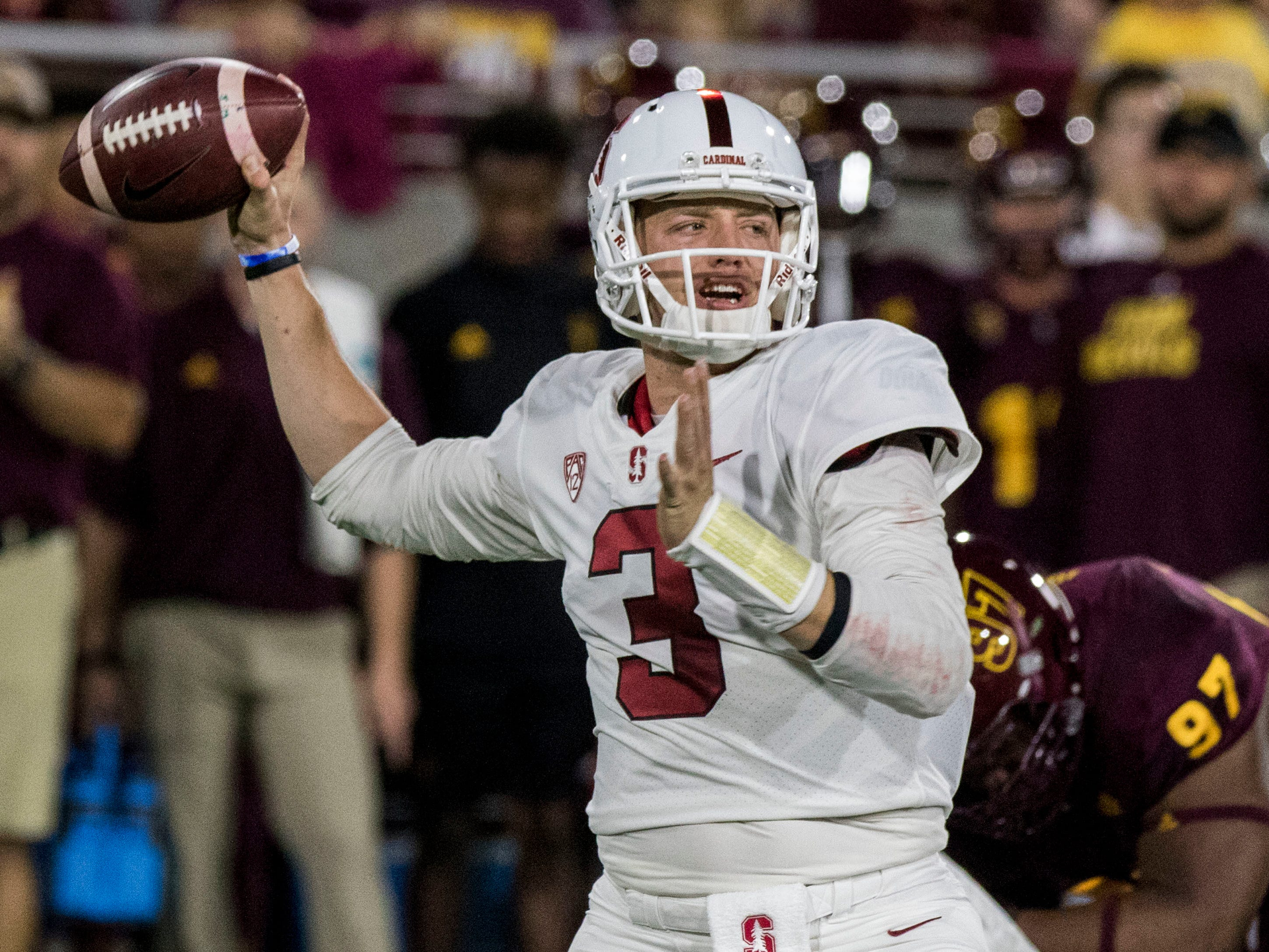 Stanford quarterback K.J. Costello throws a pass against the Arizona State defense during the first half of an NCAA college football game Thursday, Oct. 18, 2018, in Tempe, Ariz.