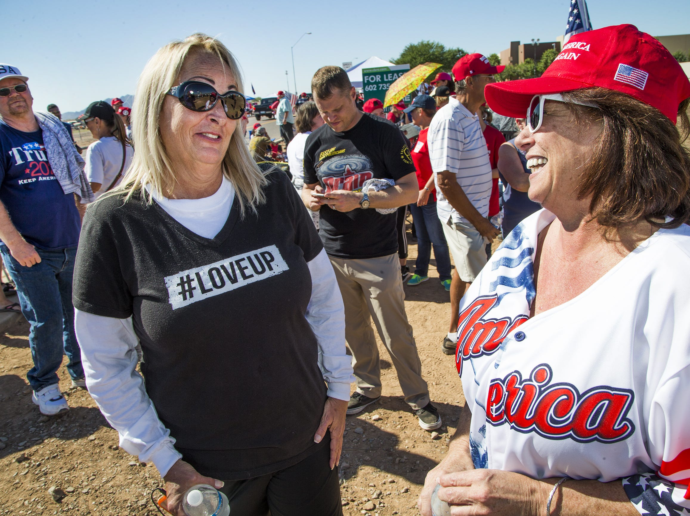 Tami Gutierrez (left) of Mesa, and Teri Lorang, of Gold Canyon, were the first two people in line to enter the International Air Response Hangar at Williams Gateway Airport on Oct. 19, 2018.