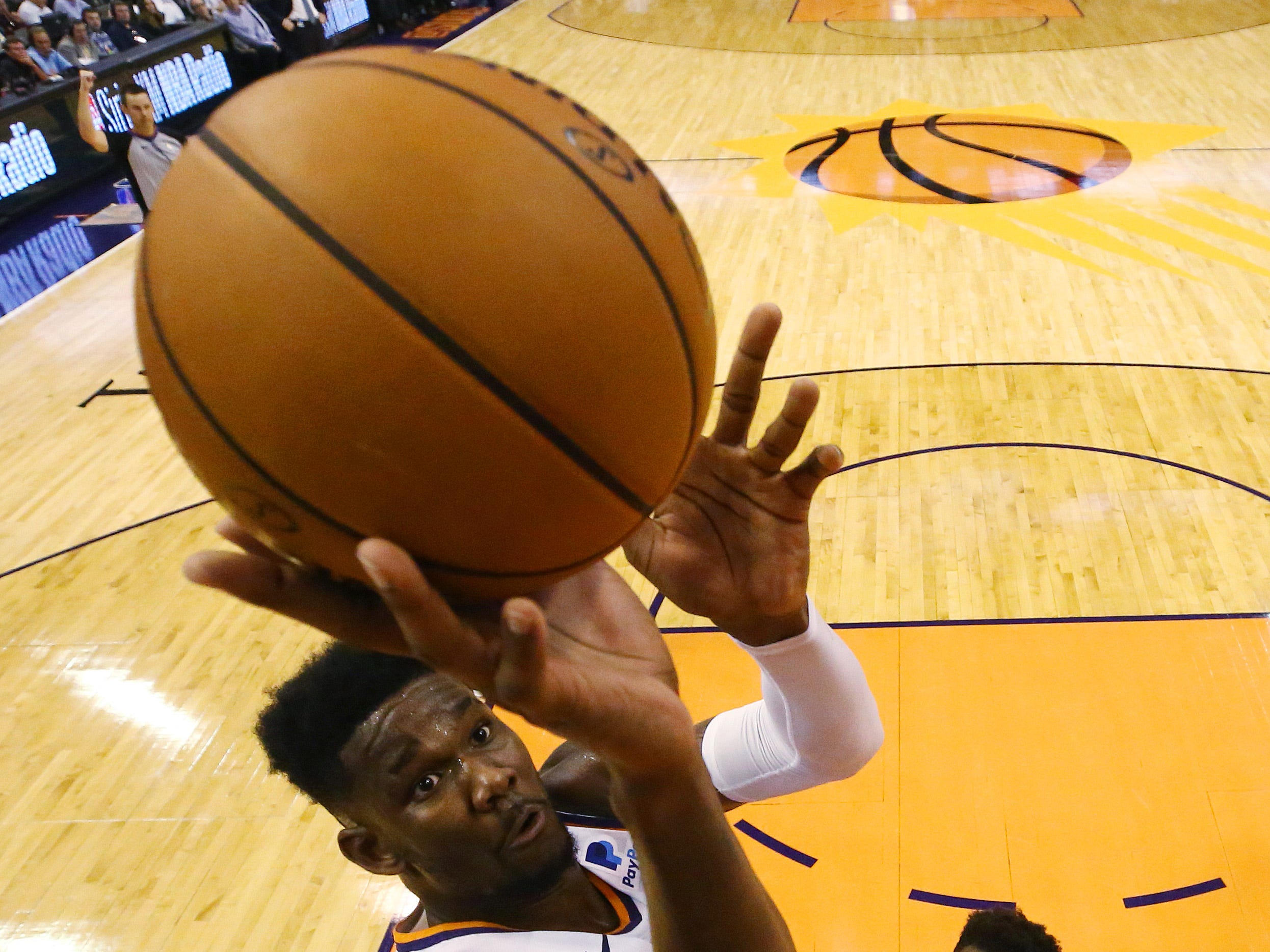 Phoenix Suns rookie center Deandre Ayton scores and is fouled on the play against the Dallas Mavericks during the season opener at Talking Stick Resort Arena on Oct. 17, 2018, in Phoenix, Ariz.