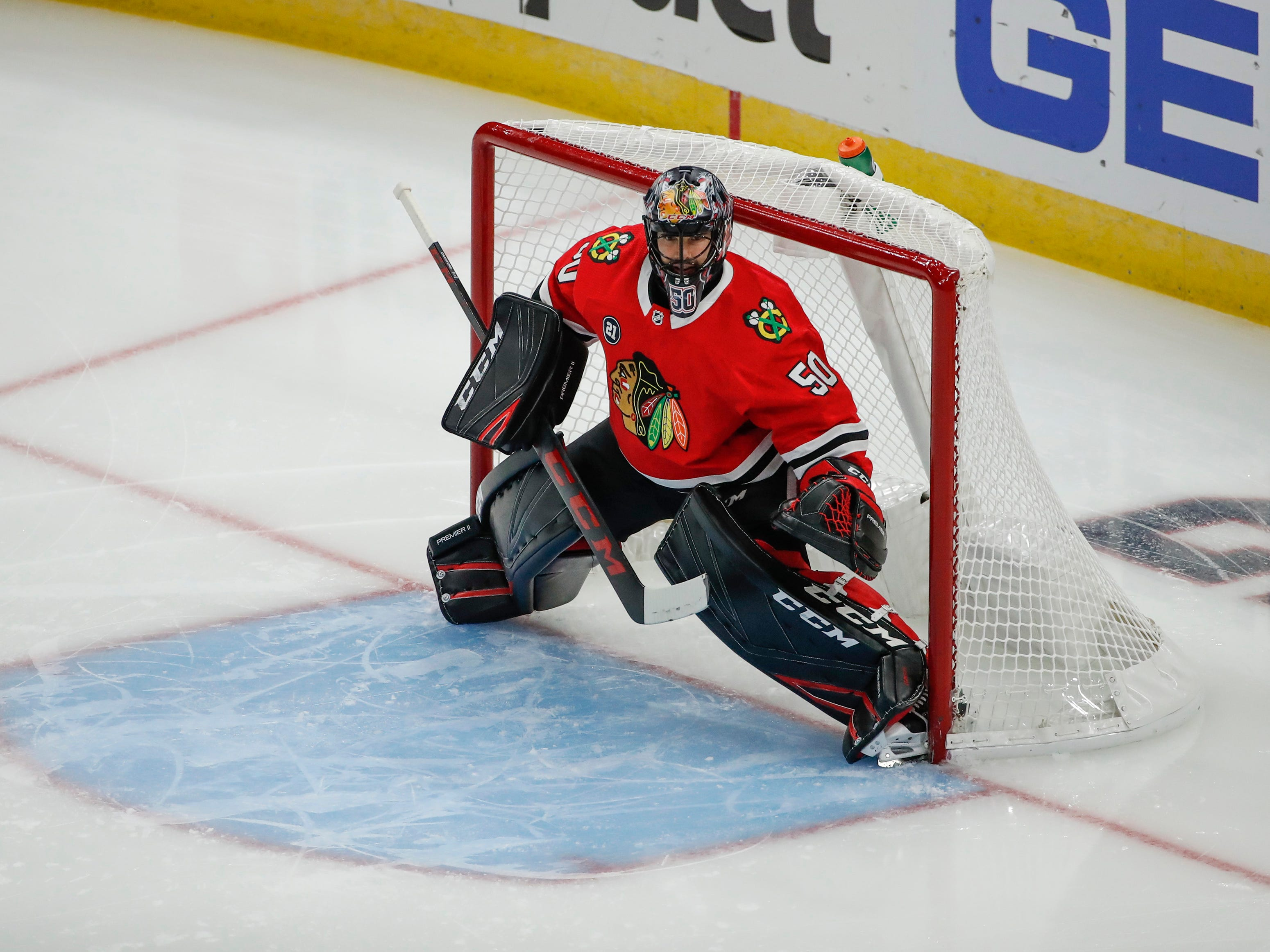 Oct 18, 2018; Chicago, IL, USA; Chicago Blackhawks goaltender Corey Crawford (50) warms up before a hockey game against the Arizona Coyotes at United Center. Mandatory Credit: Kamil Krzaczynski-USA TODAY Sports