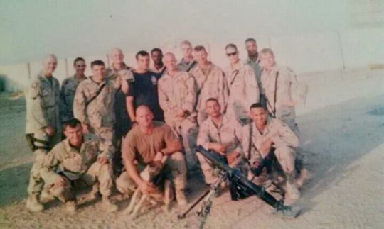 Eric Jackson (front row, far right) with his unit in Iraq in 2003.