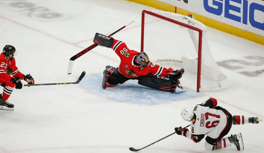 Oct 18, 2018; Chicago, IL, USA; Arizona Coyotes left wing Lawson Crouse (67) scores past Chicago Blackhawks goaltender Corey Crawford (50) during the first period at United Center. Mandatory Credit: Kamil Krzaczynski-USA TODAY Sports