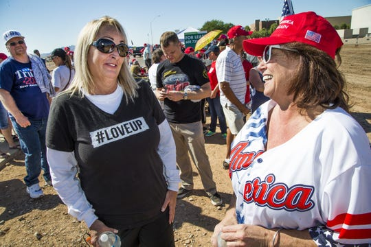 Tami Gutierrez, left, Mesa, and Teri Lorang, Gold Canyon, were the first two people in line to enter the International Air Response Hangar at Williams Gateway Airport, Friday, October 19, 2018.  President Donald Trump is to appear Friday evening for a rally supporting Senate candidate Rep. Martha McSally.
