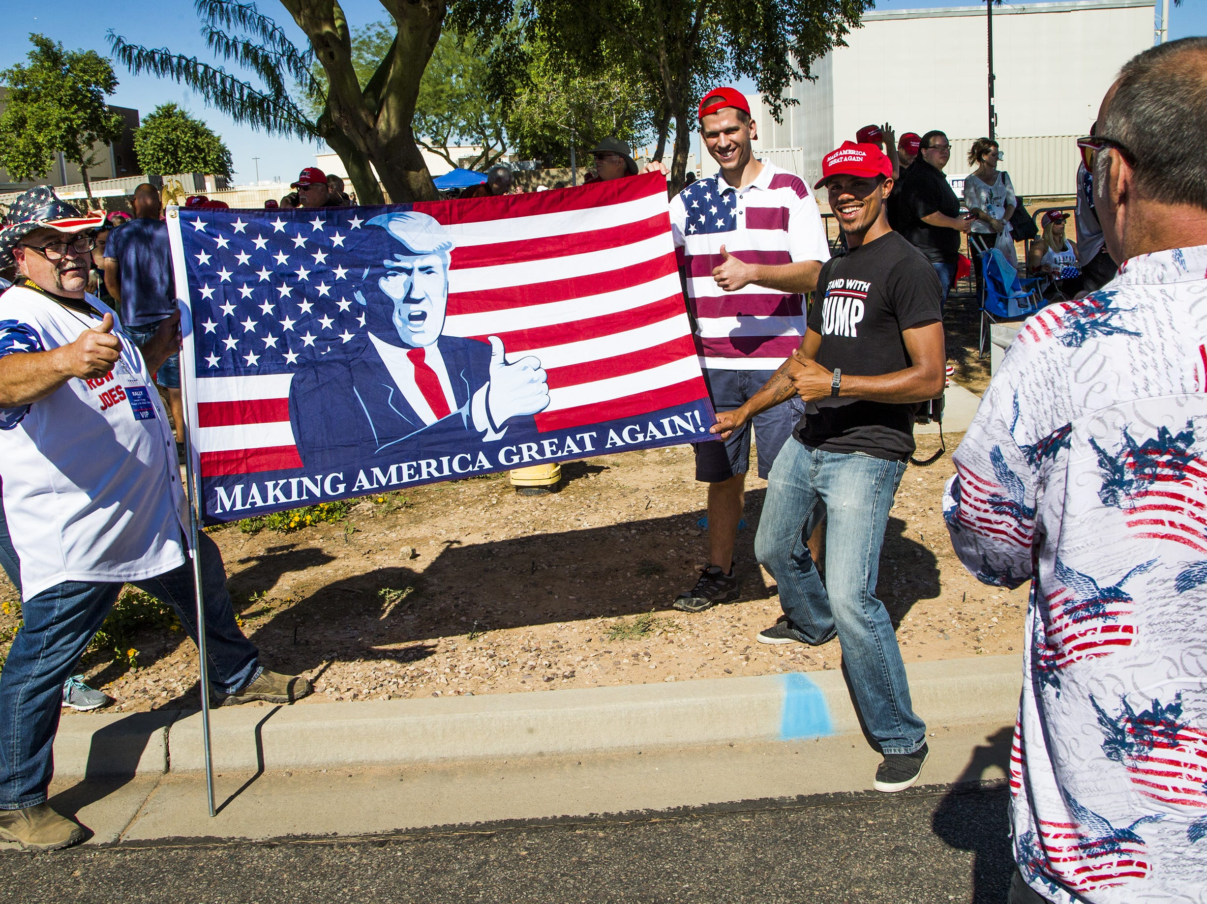 Fans of President Donald Trump wait in line to enter the International Air Response Hangar at Williams Gateway Airport on Oct. 19, 2018. Trump is set to appear Friday evening for a rally supporting Senate candidate Rep. Martha McSally.