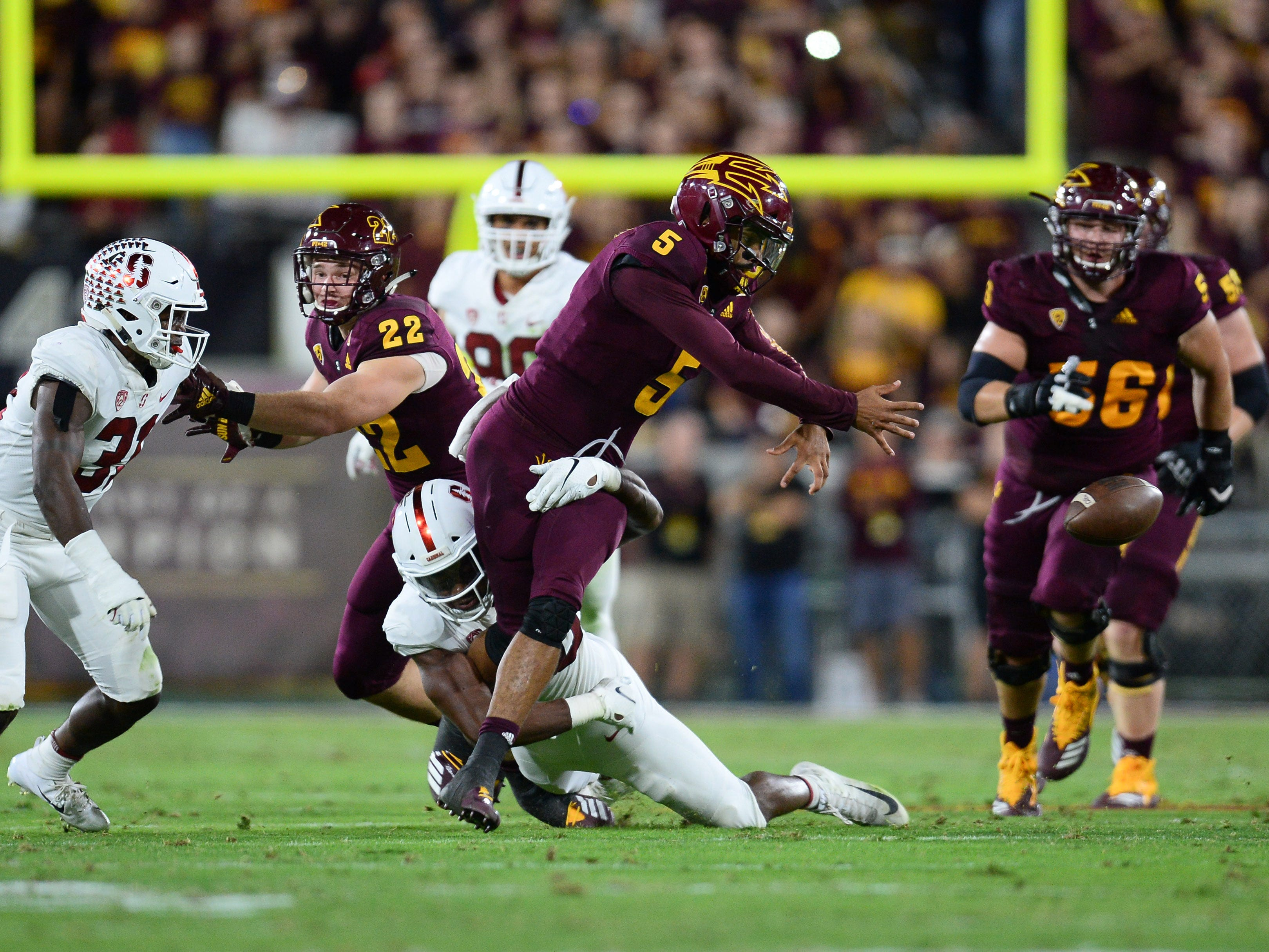 Oct 18, 2018; Tempe, AZ, USA; Arizona State Sun Devils quarterback Manny Wilkins (5) fumbles after being hit by Stanford Cardinal linebacker Bobby Okereke (20) during the first half at Sun Devil Stadium.