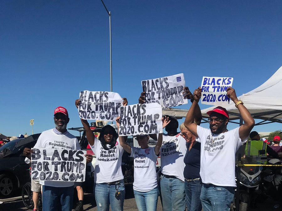 The Blacks For Trump group stands near the front of the line where President Trump supporters are asking for pictures and cheering them on on Oct. 19, 2018.