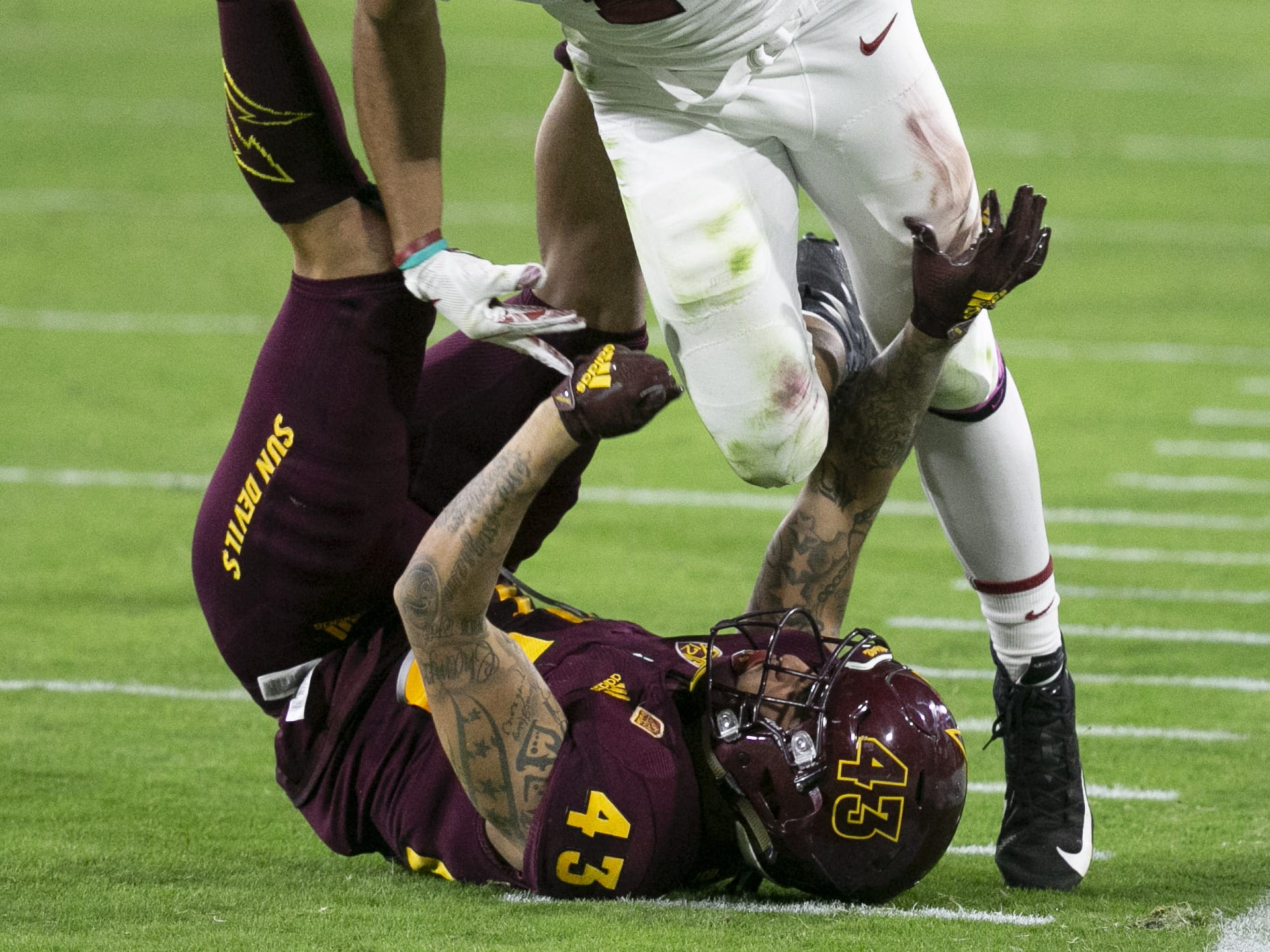 Stanford receiver JJ Arcega-Whiteside runs over ASU Jalen Harvey during the third quarter of the Pac-12 college football game at Sun Devil Stadium in Tempe on October 18, 2018.