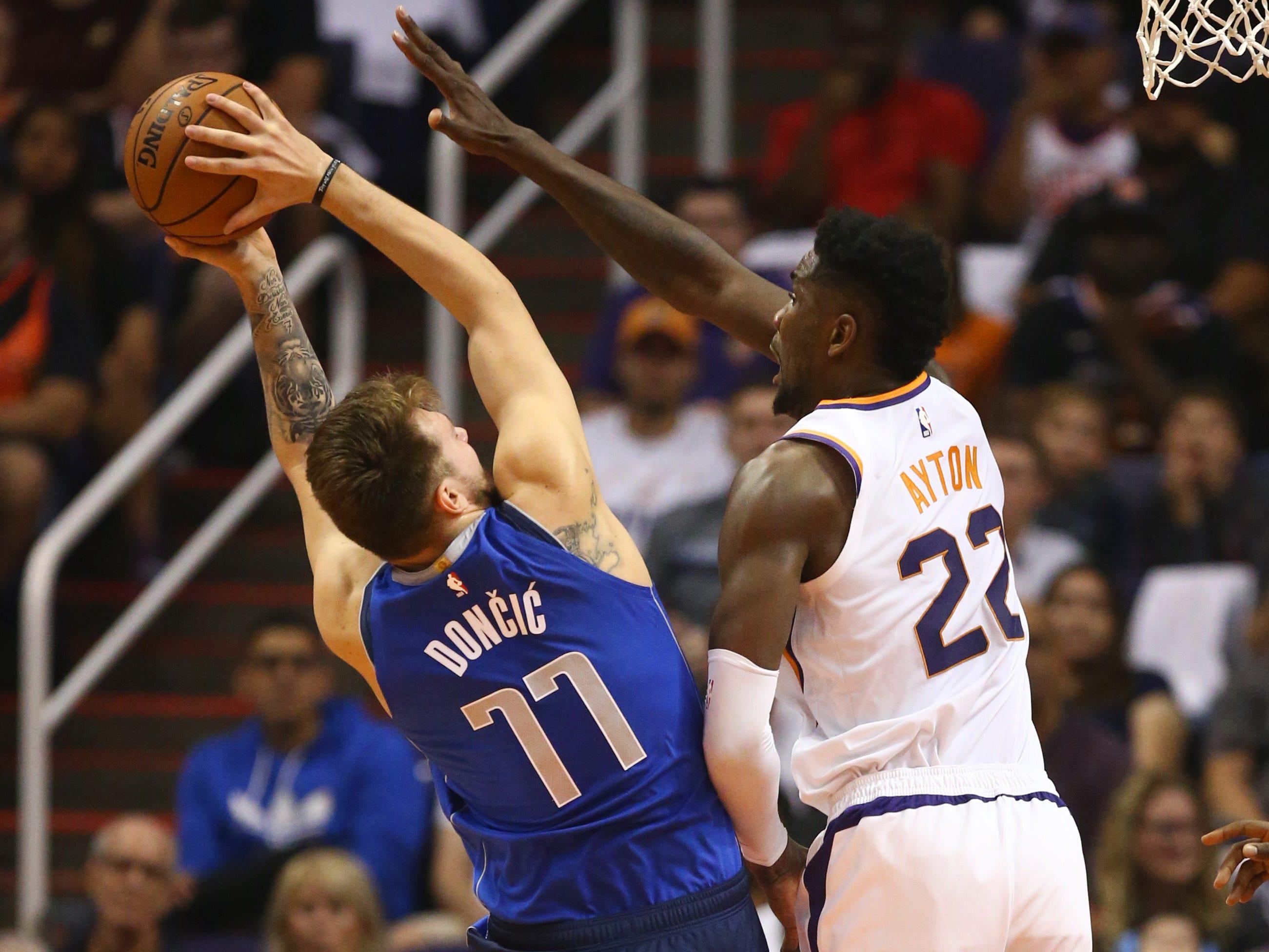 Phoenix Suns Deandre Ayton guards Dallas Mavericks Luka Doncic during the season opener at Talking Stick Resort Arena on Oct. 17, 2018, in Phoenix, Ariz.