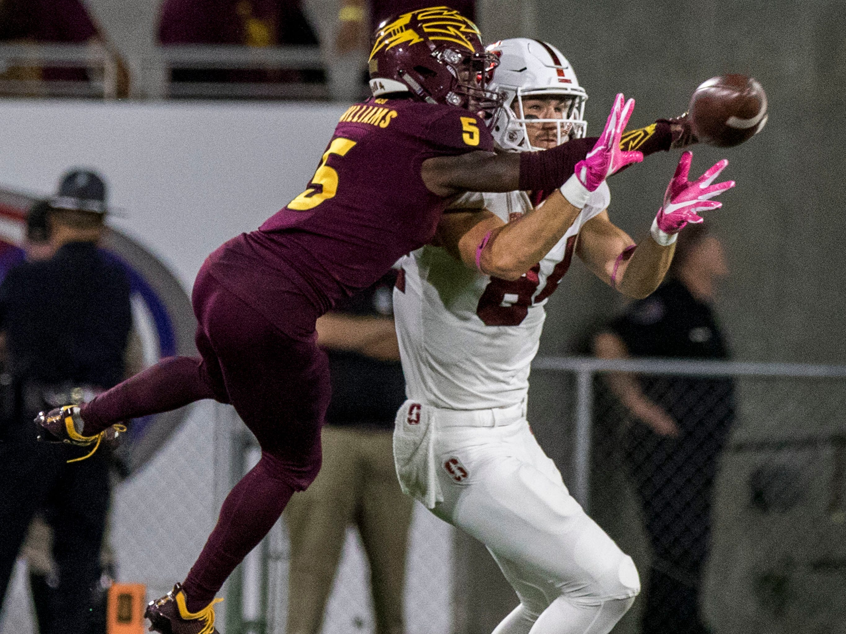 Arizona State's Kobe Williams (5) deflects the ball intended for Stanford's Colby Parkinson (84) during the first half of an NCAA college football game Thursday, Oct. 18, 2018, in Tempe, Ariz.