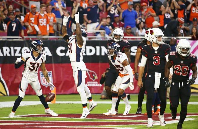 Denver Broncos linebacker Todd Davis (51) celebrates his touchdown on a intercepting a pass from Arizona Cardinals quarterback Josh Rosen (3) in the first half at State Farm Stadium in Glendale, Ariz.