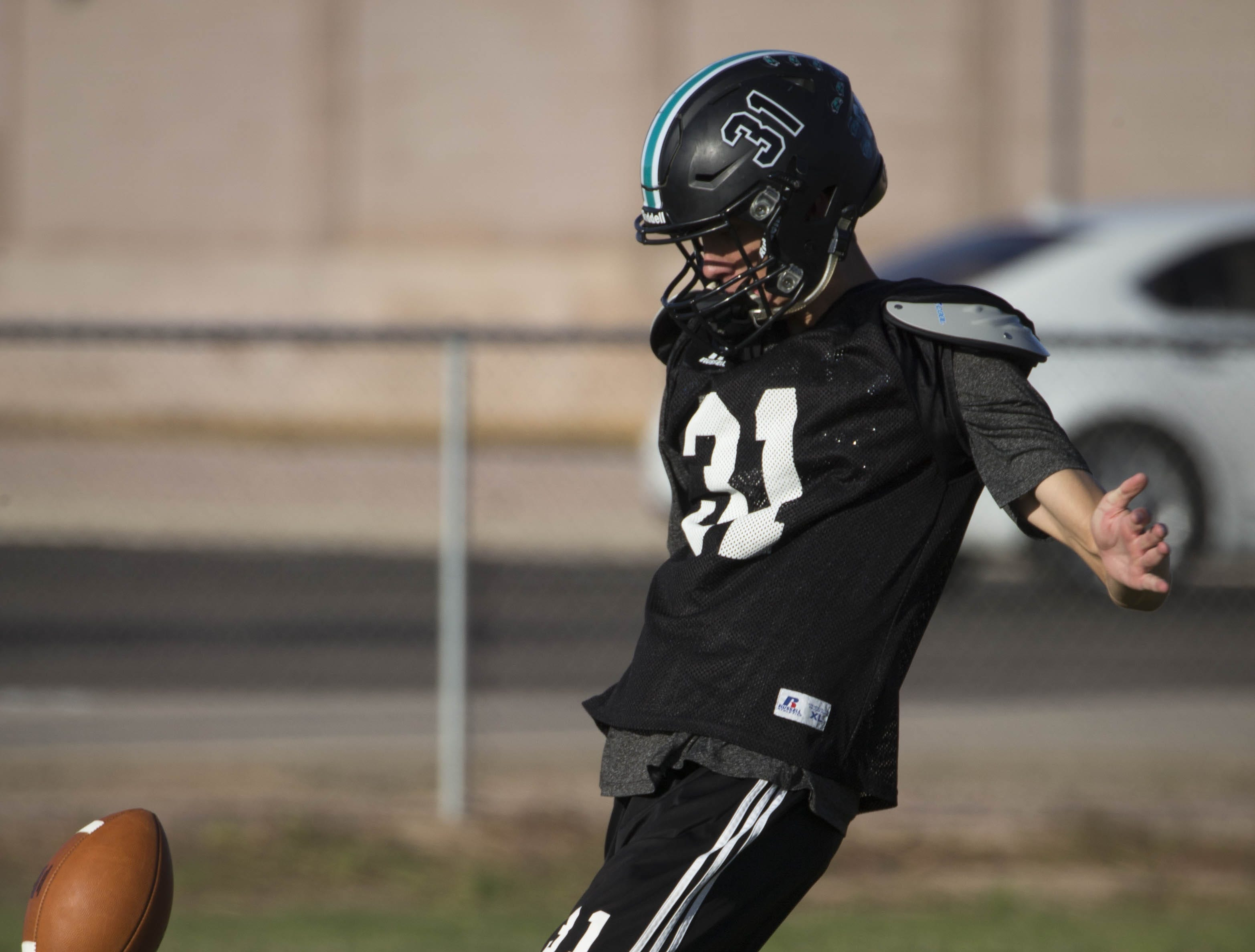Austin McNamara punts the ball during football practice, October 17, 2018, at Highland High School, Gilbert.