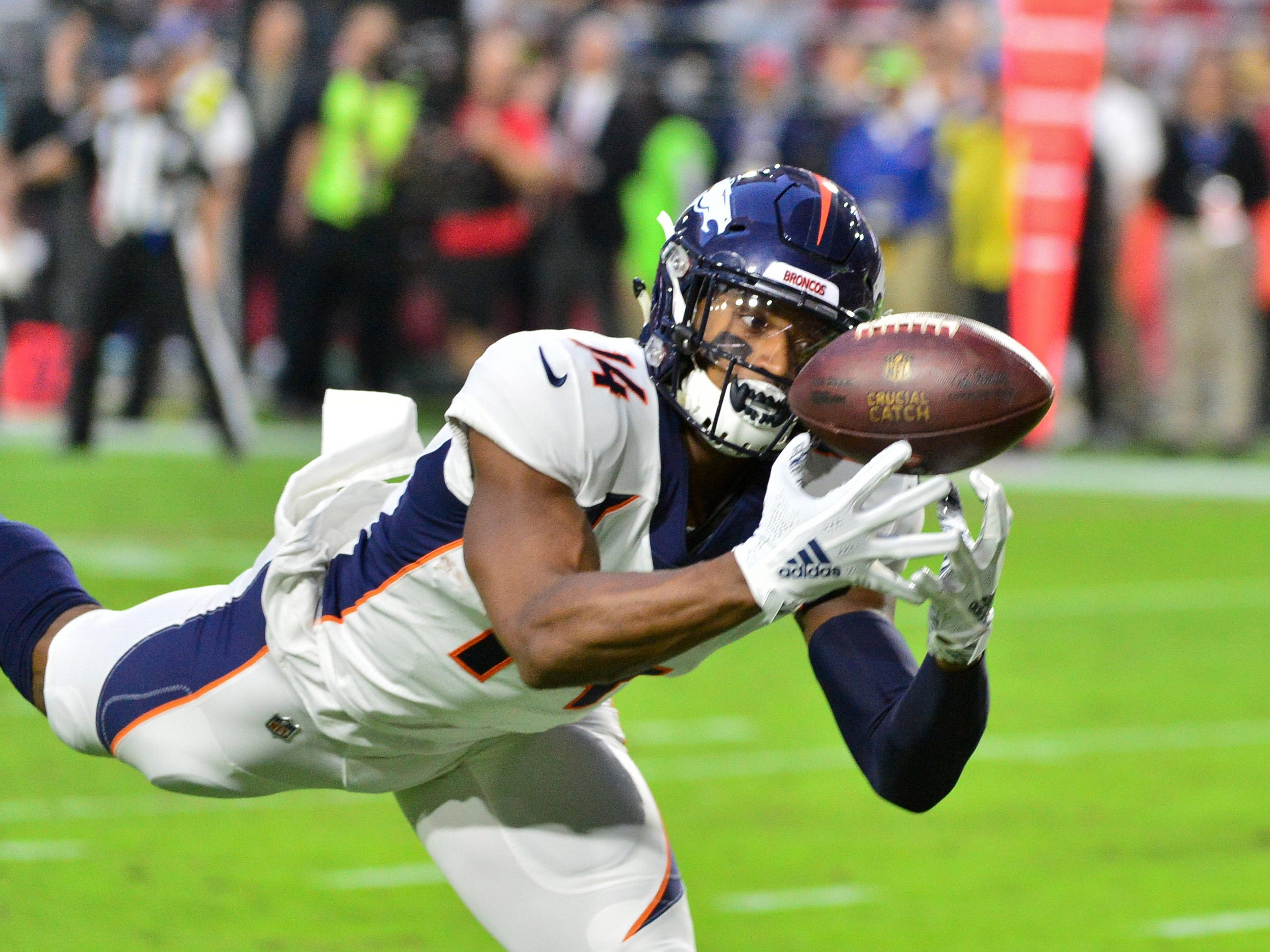 Oct 18, 2018; Glendale, AZ, USA; Denver Broncos wide receiver Courtland Sutton (14) makes a catch for a touchdown  during the first half against the Arizona Cardinals at State Farm Stadium.