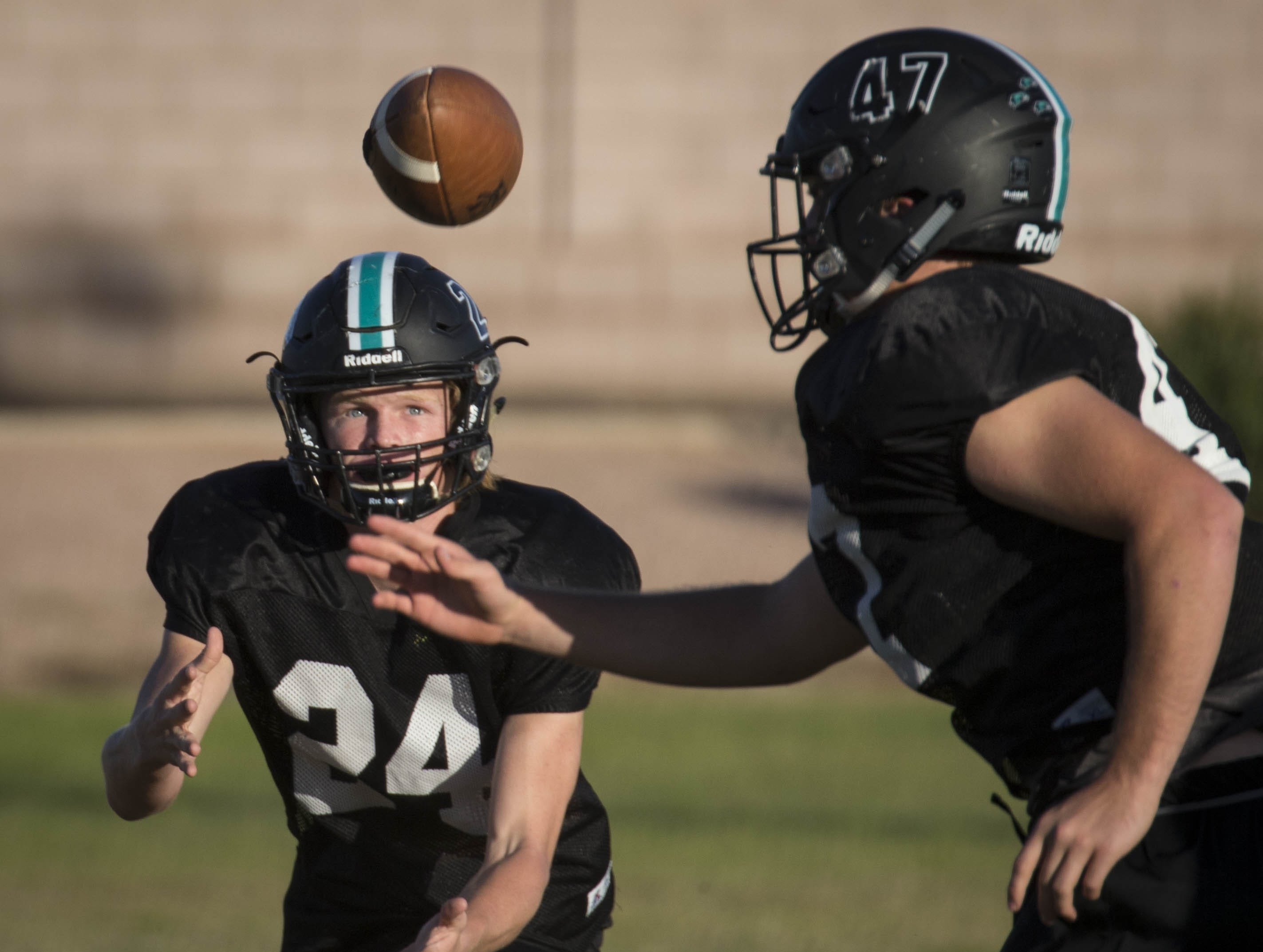 Cade Camac intercepts a pass during football practice, October 17, 2018, at Highland High School, Gilbert.