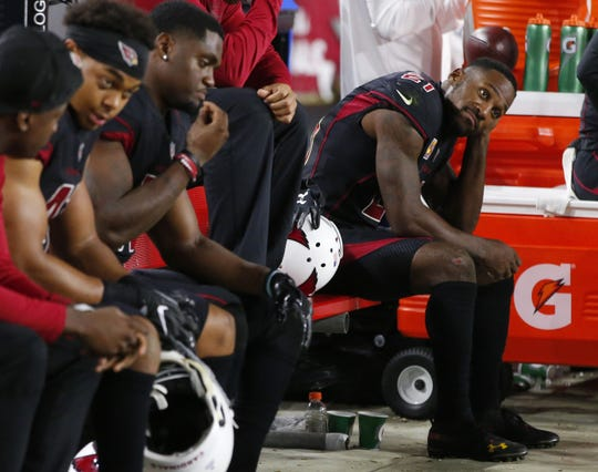 Arizona Cardinals cornerback Patrick Peterson (21) sits dejected on the bench after losing to the Denver Broncos at State Farm Stadium in Glendale on October 18, 2018.