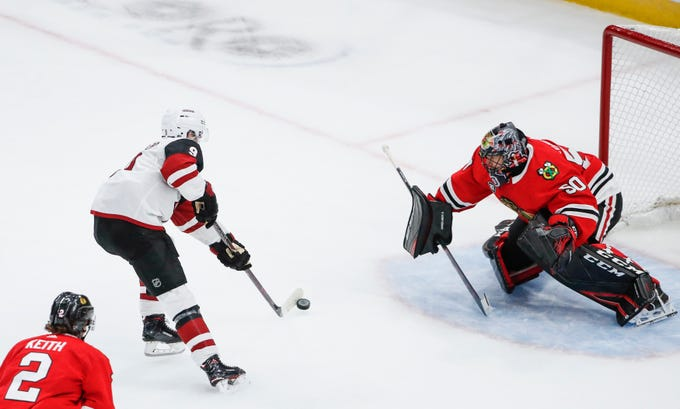 Oct 18, 2018; Chicago, IL, USA; Arizona Coyotes center Clayton Keller (9) shoots and scores against Chicago Blackhawks goaltender Corey Crawford (50) during the third period at United Center.