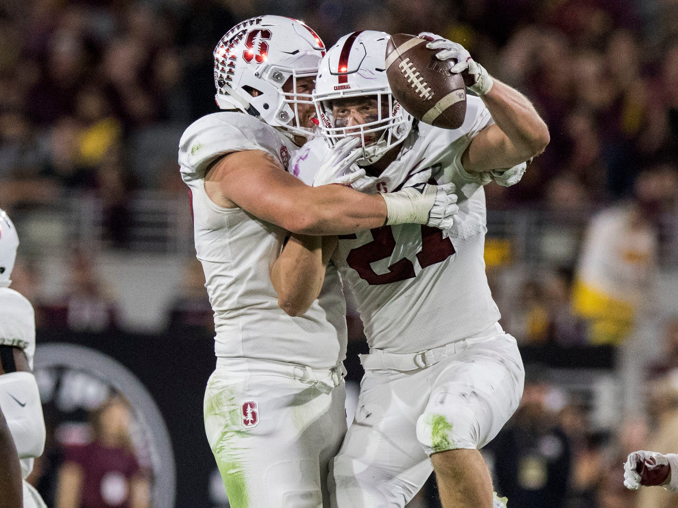 Stanford's Sean Barton (27) celebrates his interception against Arizona State with teammate Dylan Jackson during the first half of an NCAA college football game Thursday, Oct. 18, 2018, in Tempe, Ariz.