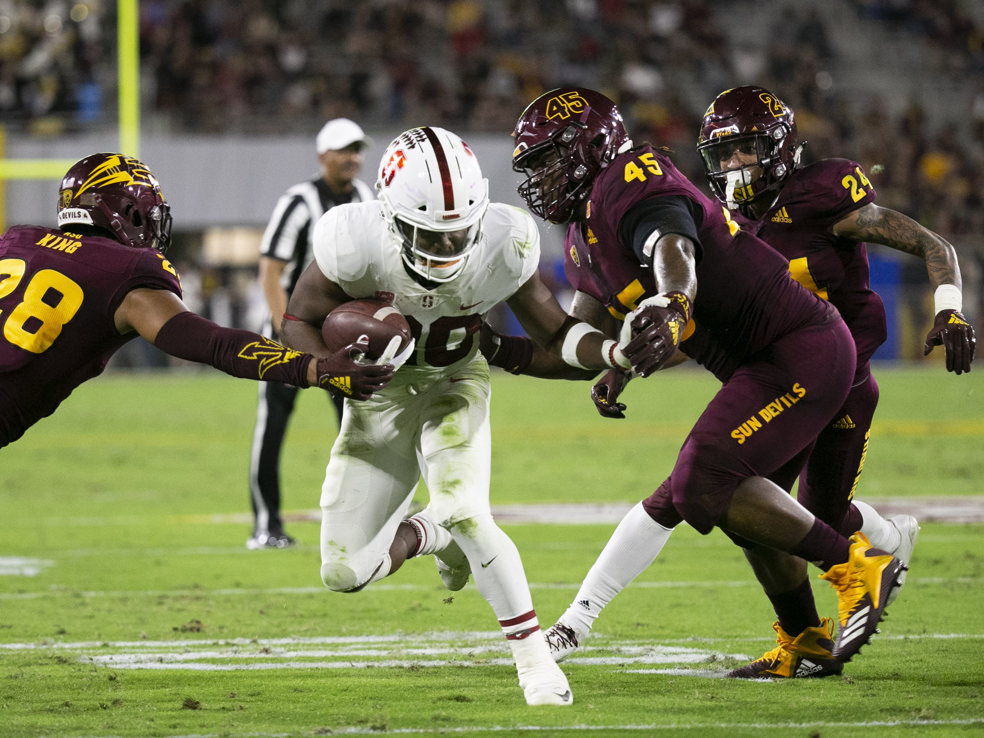 Dress Demonte King (28) and George Lea (45) go in for the tackle against Stanford running back Bryce Love during the first quarter of the Pac-12 college football game at Sun Devil Stadium in Tempe on October 18, 2018.