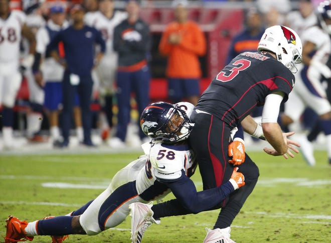 Denver Broncos linebacker Von Miller (58) sacks Arizona Cardinals quarterback Josh Rosen (3) causing a fumble during a football game at State Farm Stadium in Glendale on October 18, 2018.