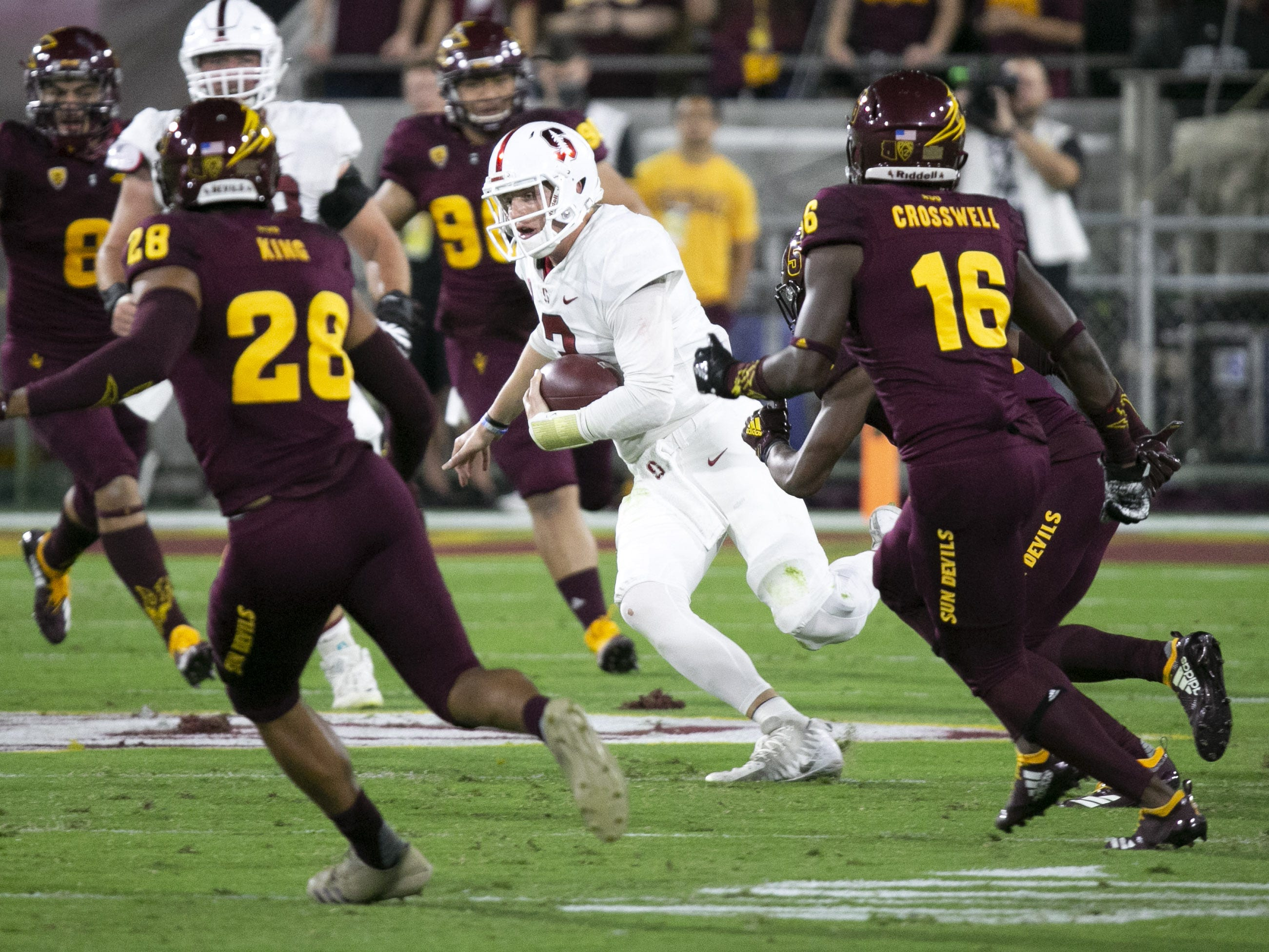 Stanford quarterback K.J. Costello carries the ball against the ASU defense during the first quarter of the Pac-12 college football game at Sun Devil Stadium in Tempe on October 18, 2018.