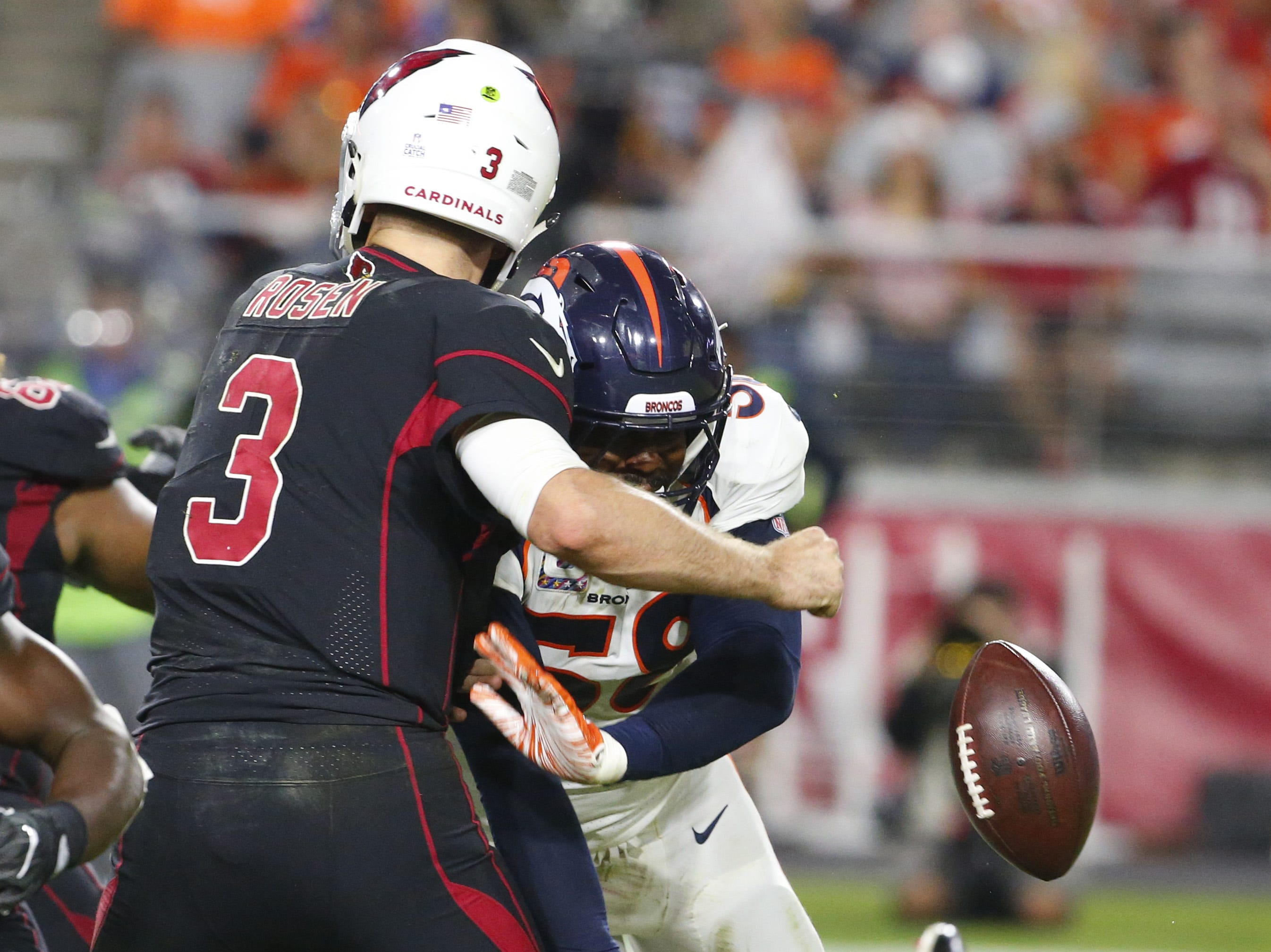 Denver Broncos linebacker Von Miller (58) causes Arizona Cardinals quarterback Josh Rosen (3) to fumble the ball during a football game at State Farm Stadium in Glendale on October 18, 2018.