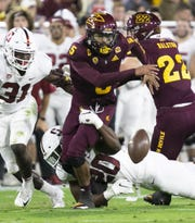 ASU quarterback Manny Wilkins fumbles the ball from Stanford linebacker Bobby Okereke during the second quarter of the Pac-12 college football game at Sun Devil Stadium in Tempe on October 18, 2018.