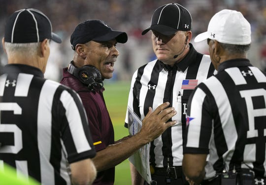 ASU head coach Herm Edwards argues with the officials during the second quarter of the Pac-12 college football game against Stanford at Sun Devil Stadium in Tempe on October 18, 2018.