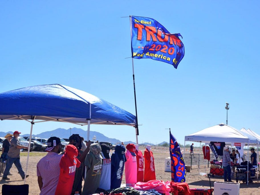 A  Trump merchandise stand outside of Phoenix-Mesa Gateway Airport on Oct. 19, 2018.