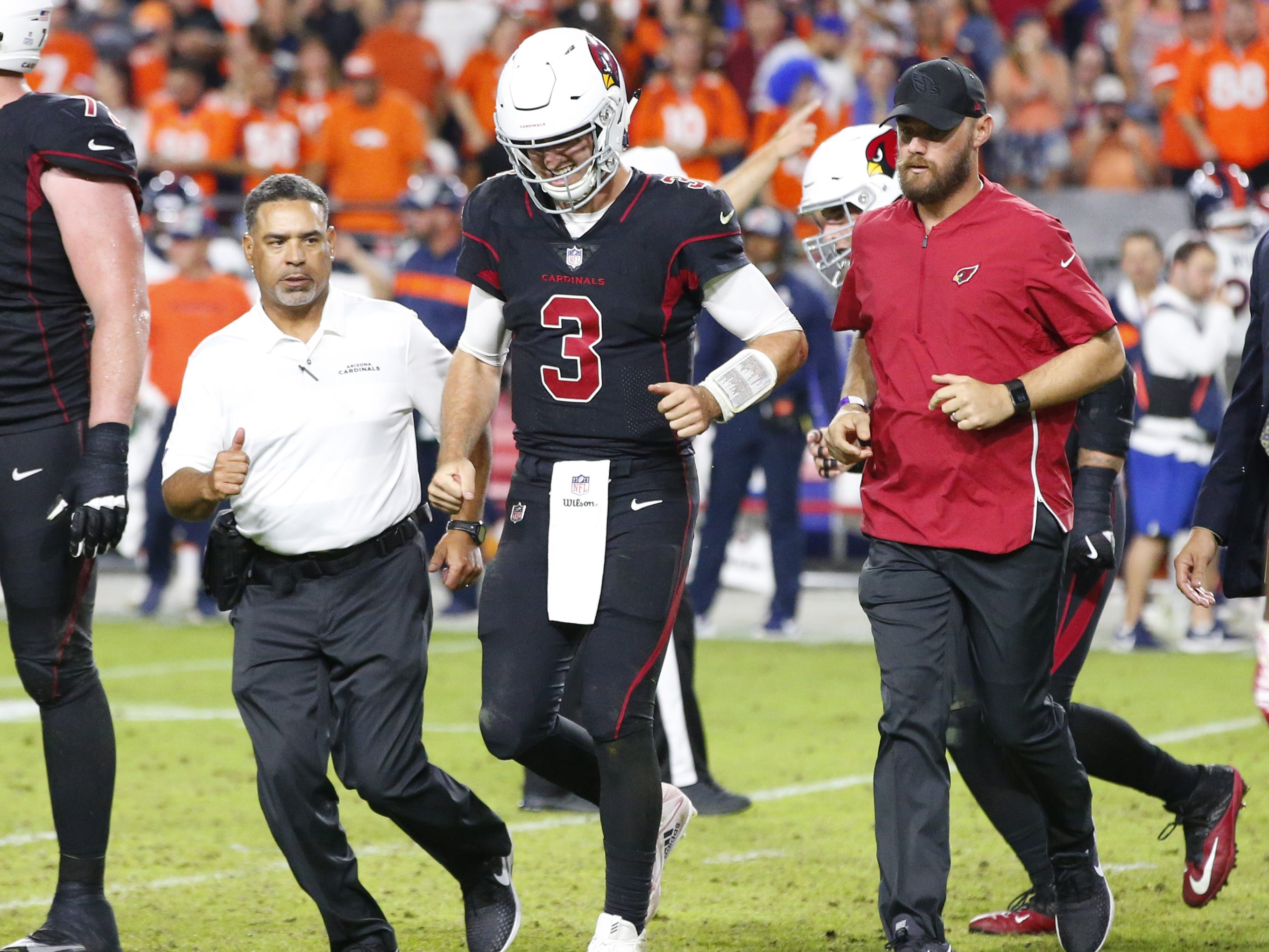 Arizona Cardinals quarterback Josh Rosen (3) walks off the field after suffering an injury during a football game against the Denver Broncos at State Farm Stadium in Glendale on October 18, 2018.