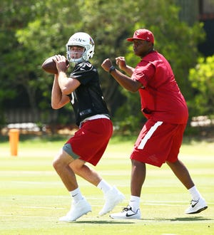 Quarterback Josh Rosen works-out with coach Byron Leftwich during the Cardinals rookie mini-camp practice on May 11, 2018 at the Arizona Cardinals Training Facility in Tempe, Ariz.