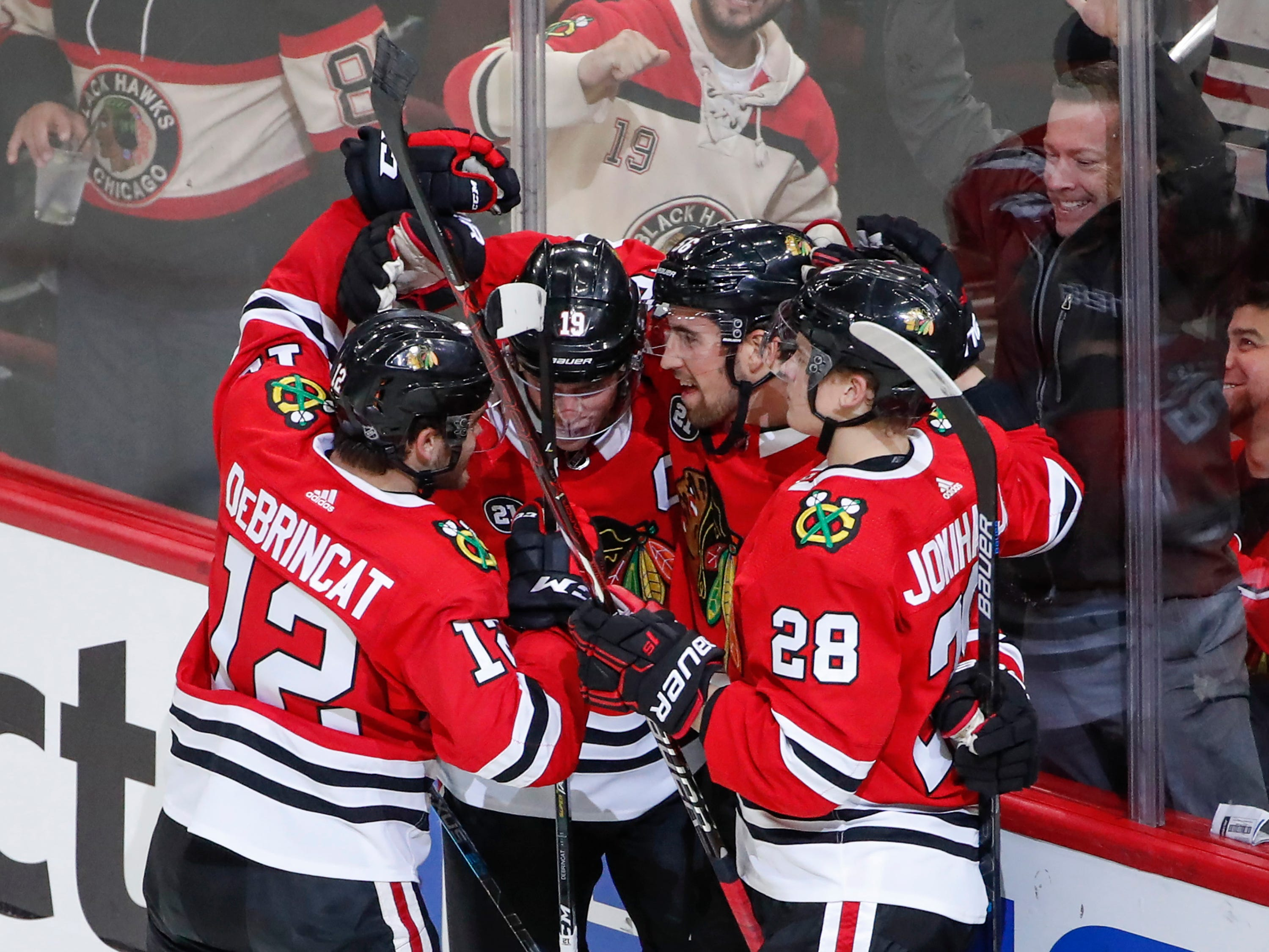 Oct 18, 2018; Chicago, IL, USA; Chicago Blackhawks defenseman Erik Gustafsson (56) celebrates with teammates after scoring against the Arizona Coyotes during the second period at United Center.