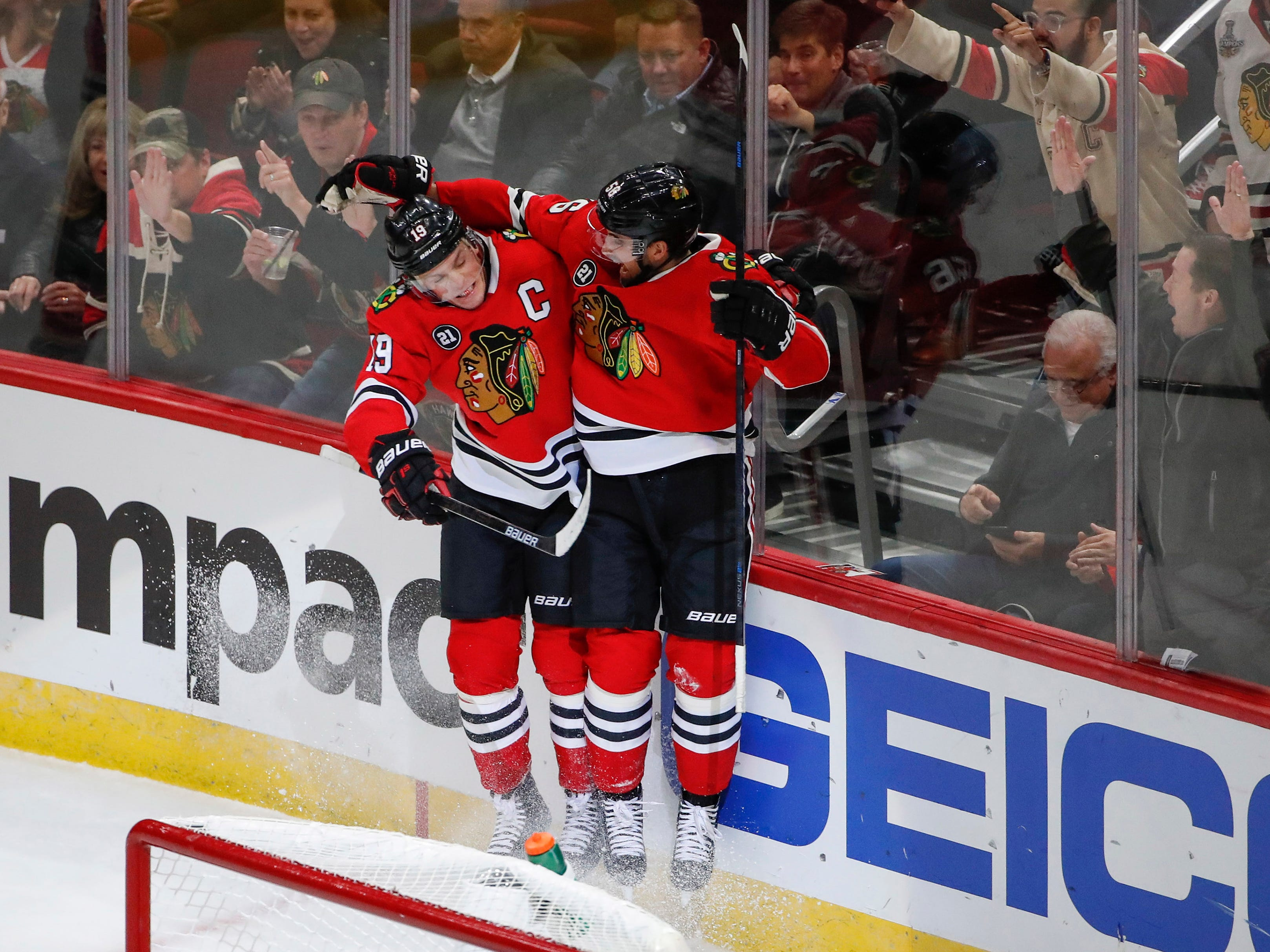 Oct 18, 2018; Chicago, IL, USA; Chicago Blackhawks defenseman Erik Gustafsson (56) celebrates with center Jonathan Toews (19) after scoring against the Arizona Coyotes during the second period at United Center.