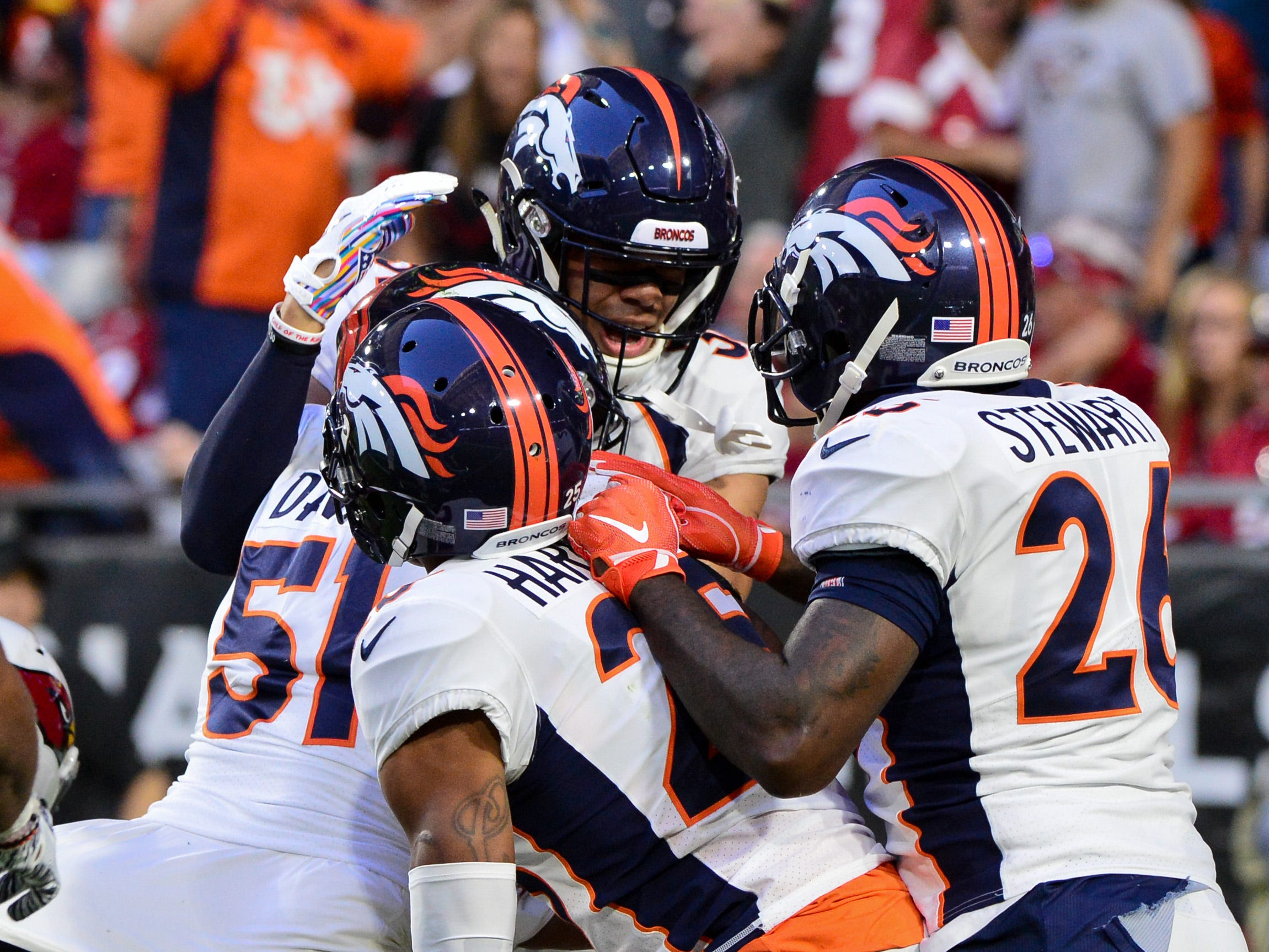 Oct 18, 2018; Glendale, AZ, USA; Denver Broncos linebacker Todd Davis (51) celebrates with teammates after returning an interception for a touchdown during he first half against the Arizona Cardinals at State Farm Stadium.
