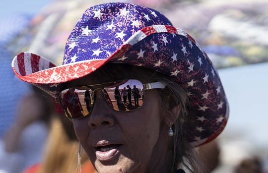 President Donald Trump supporter Sheridan Beaulieu, from Florence, Az., came to watch the president's speech supporting Martha McSally at Phoenix-Mesa Gateway Airport on Oct. 19, 2018.