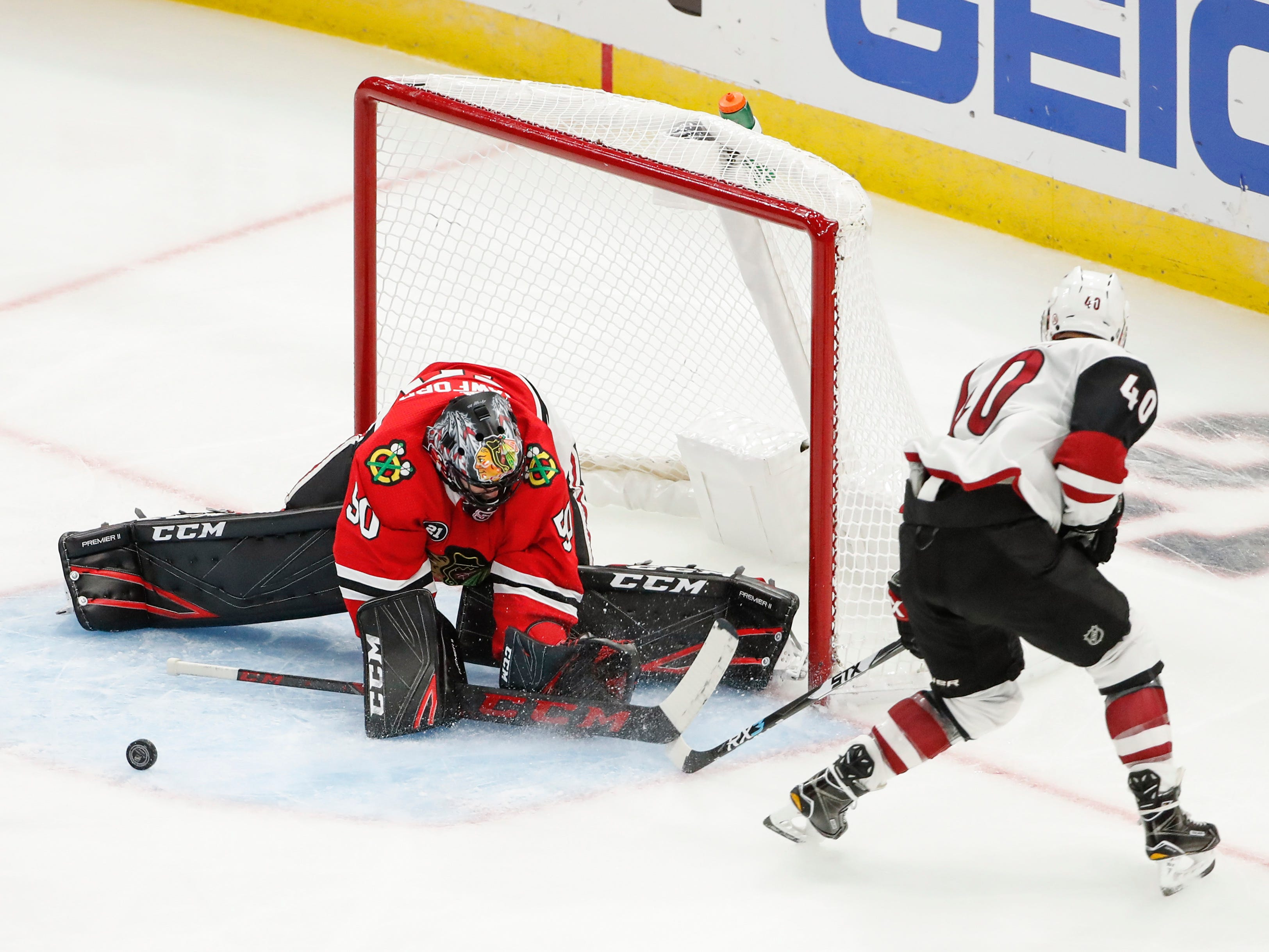 Oct 18, 2018; Chicago, IL, USA; Chicago Blackhawks goaltender Corey Crawford (50) defends a shot by Arizona Coyotes right wing Michael Grabner (40) during the third period at United Center.