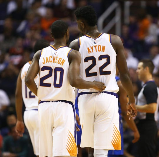 Josh Jackson and Deandre Ayton talk as they come off the court during a game against the Mavericks at Talking Stick Resort Arena.