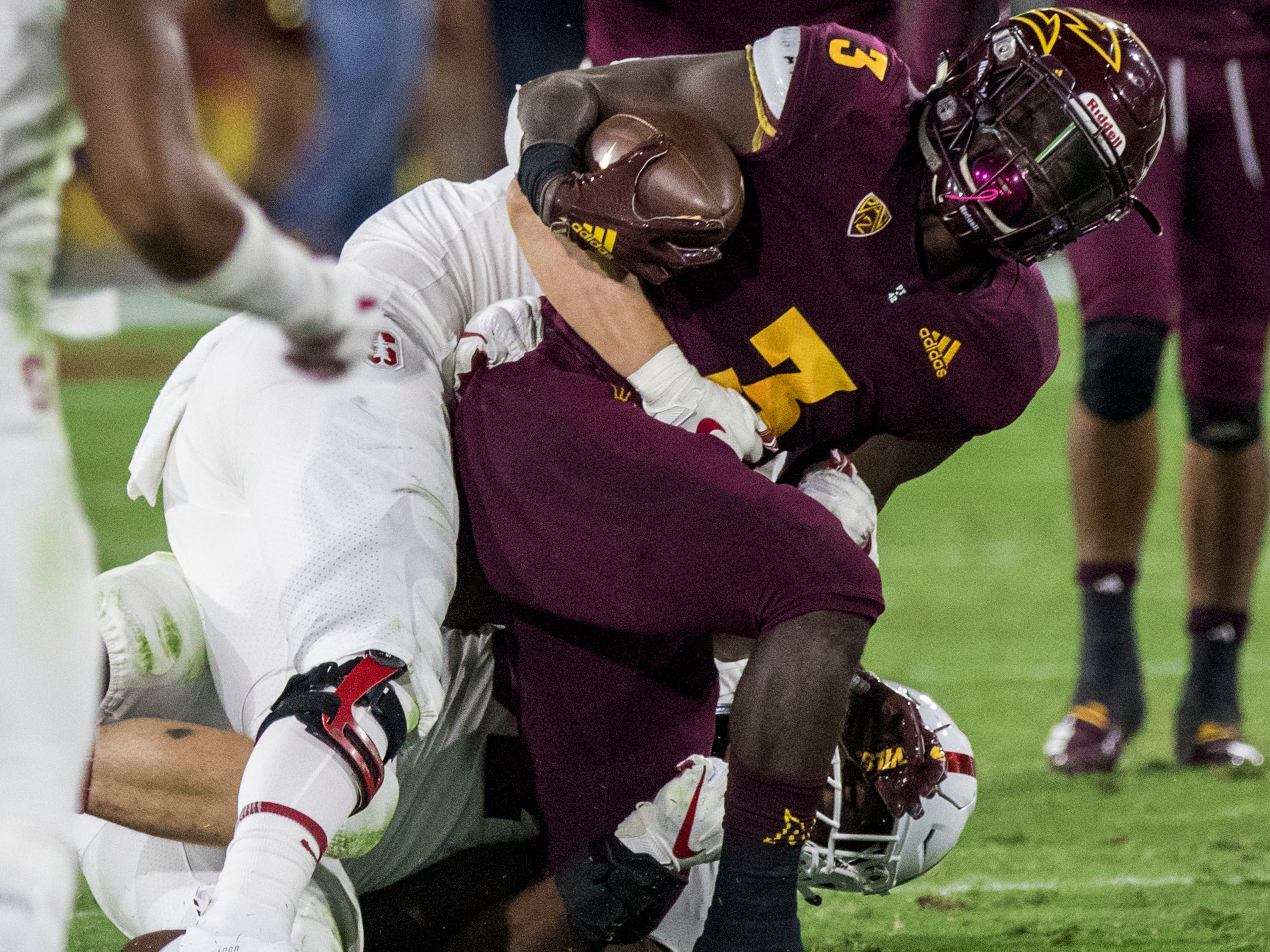 Arizona State's Eno Benjamin gets tackled by Stanford's Michael Williams during the first half of an NCAA college football game Thursday, Oct. 18, 2018, in Tempe, Ariz.