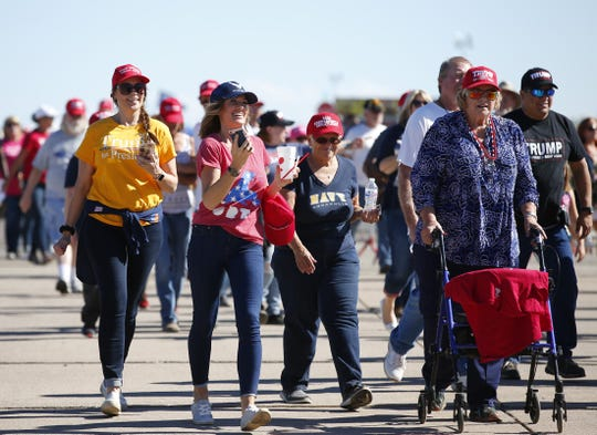 Trump supporters enter the International Air Response Hangar in Mesa for the Make America Great Again Rally on Oct. 18, 2019.
