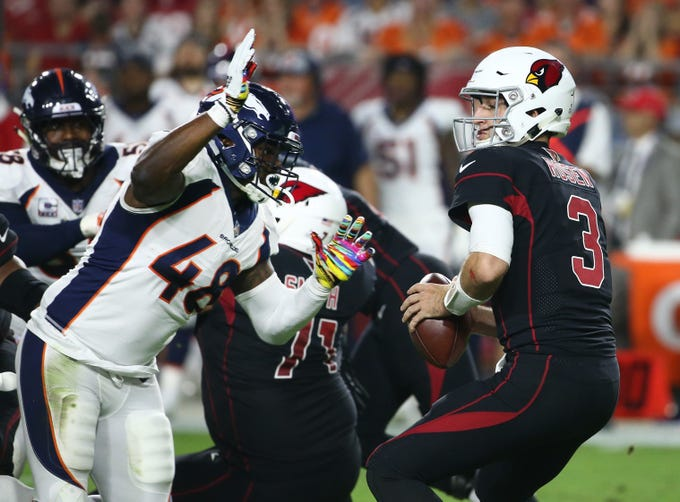 a40d7911d8d Arizona Cardinals Josh Rosen is sacked by Denver Broncos Shaquil Barrett in  the first half at