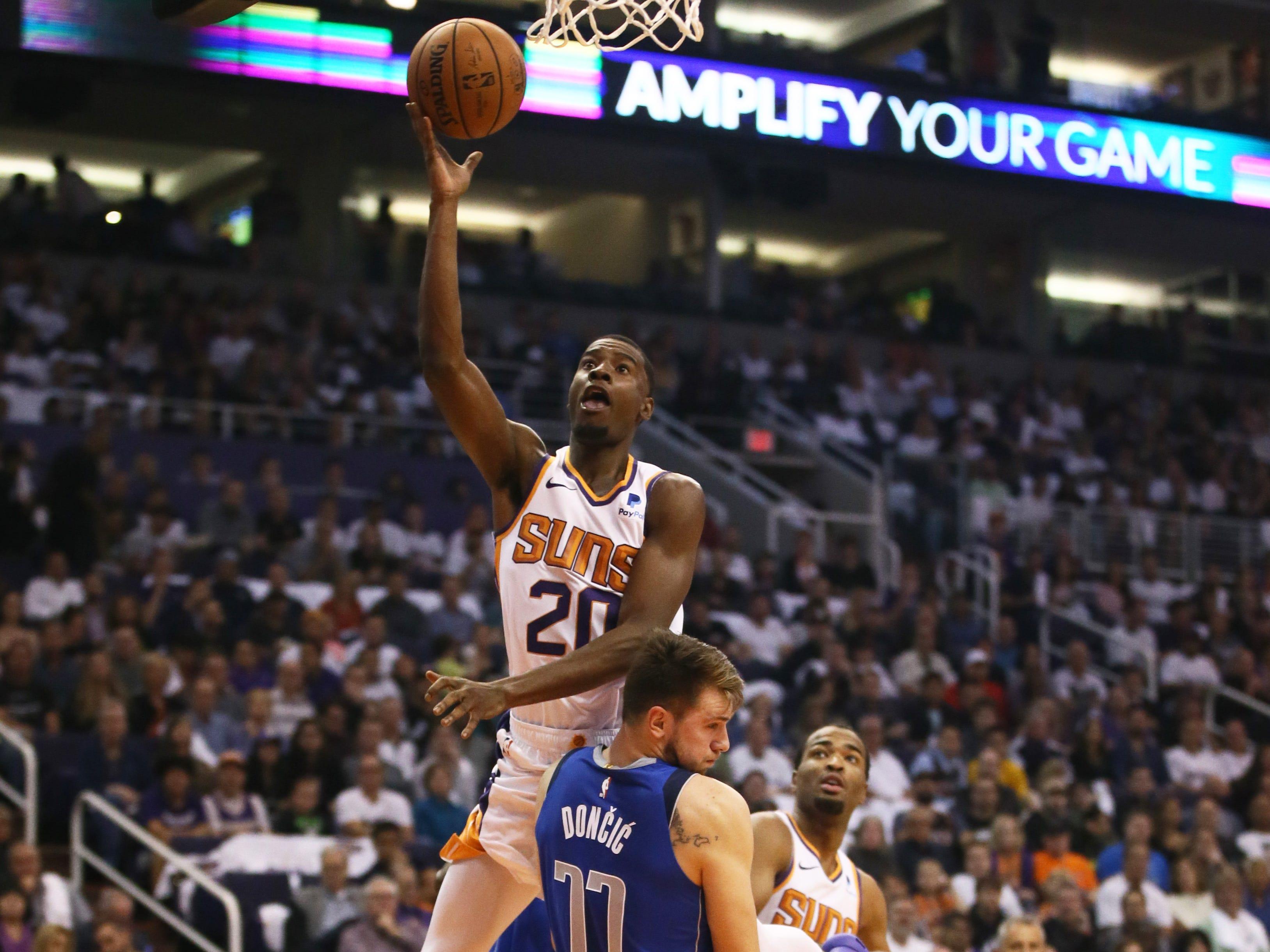 Phoenix Suns Josh Jackson shoots and scores against the Dallas Mavericks during the season opener at Talking Stick Resort Arena on Oct. 17, 2018, in Phoenix, Ariz.
