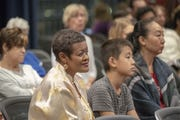 Debora Colbert (at left), Alexander Sun (at center) with his mother Leezah Sun listen to a forum on education and school choice hosted by The Arizona Republic and HuffPost at the Tempe Center for the Arts on Oct. 18, 2018.