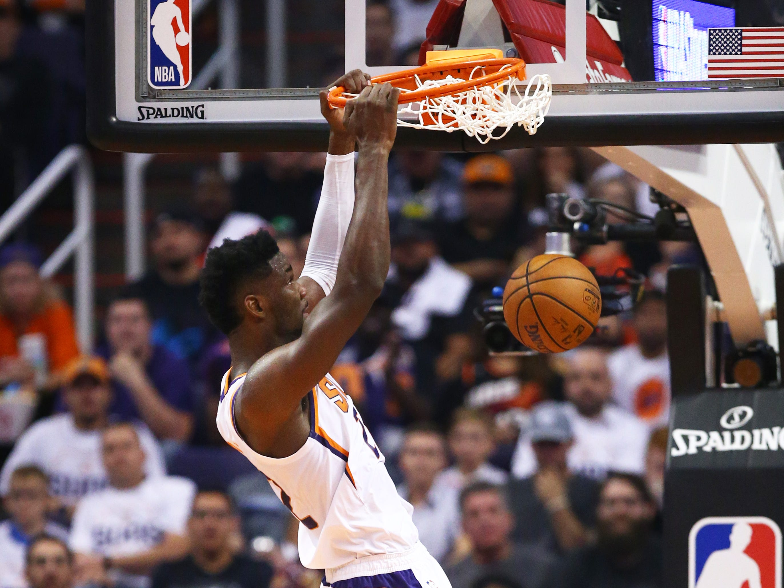 Phoenix Suns center Deandre Ayton dunks the ball against the Dallas Mavericks during the season opener at Talking Stick Resort Arena on Oct. 17, 2018, in Phoenix, Ariz.